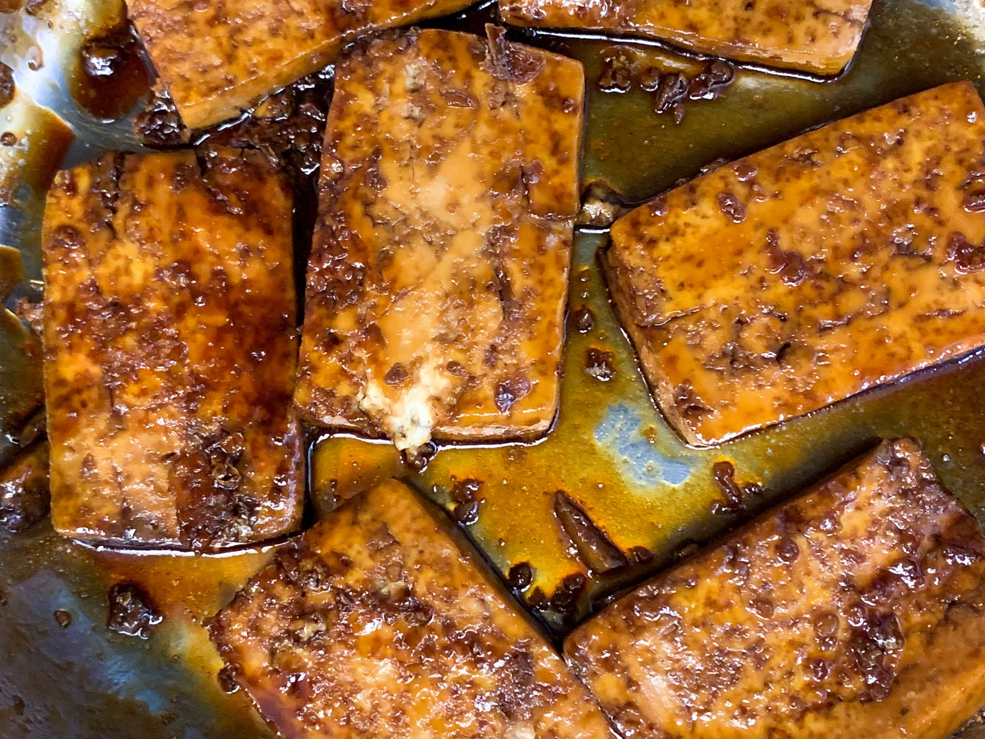 finished sweet and sour tofu in pan with an eggy texture