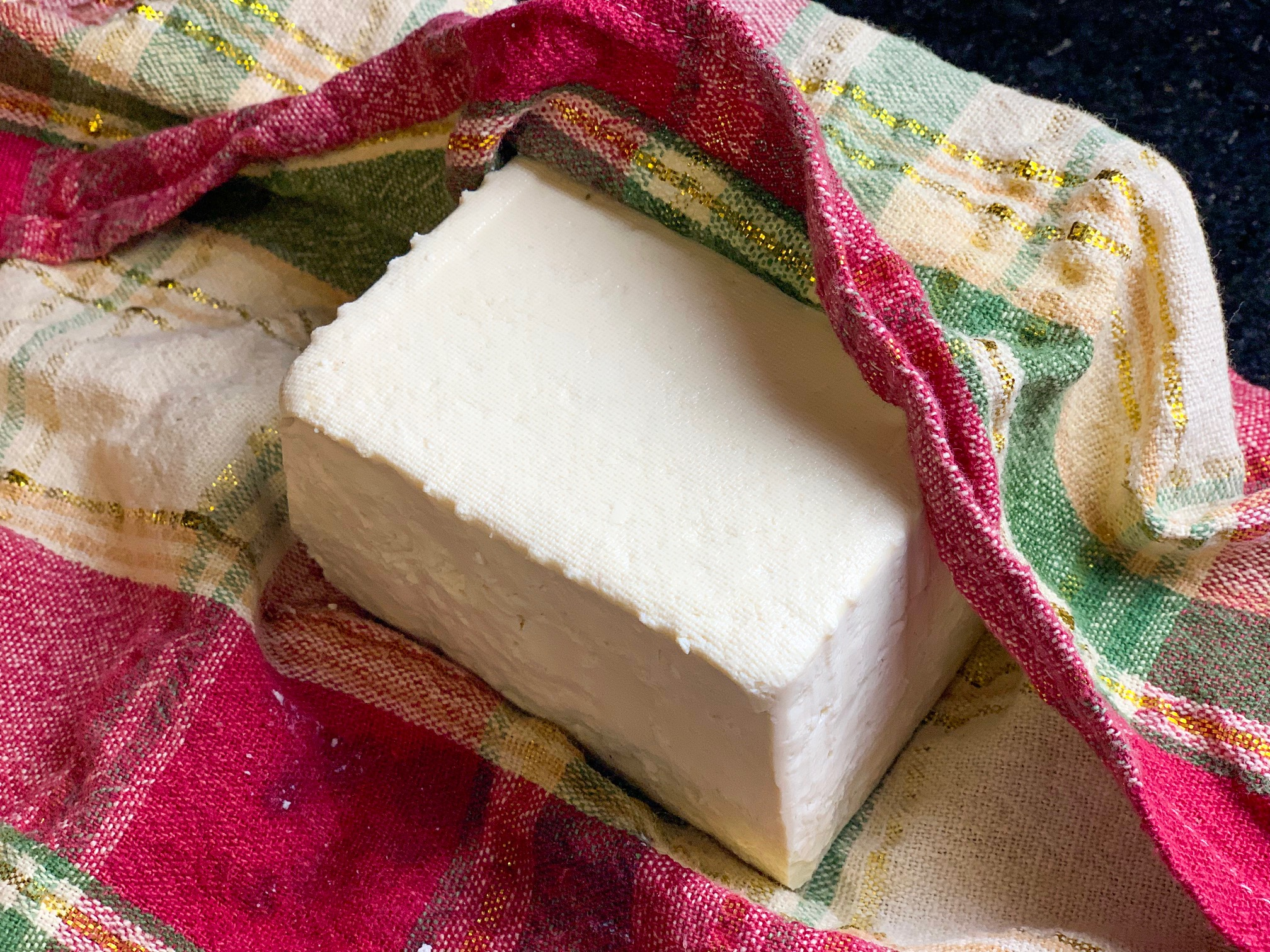 draining tofu in a towel ready for prep