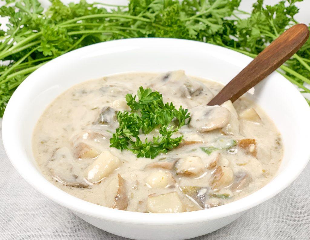 bowl of vegan clam chowder garnished with parsley