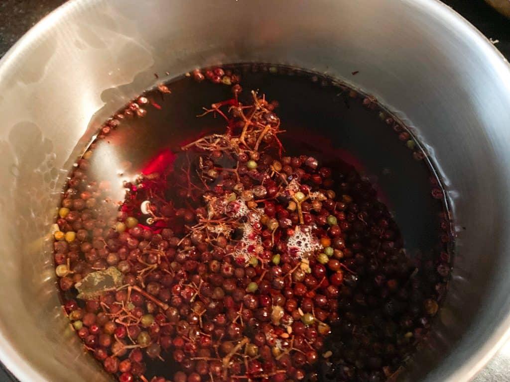 elderberries in pot before boiling