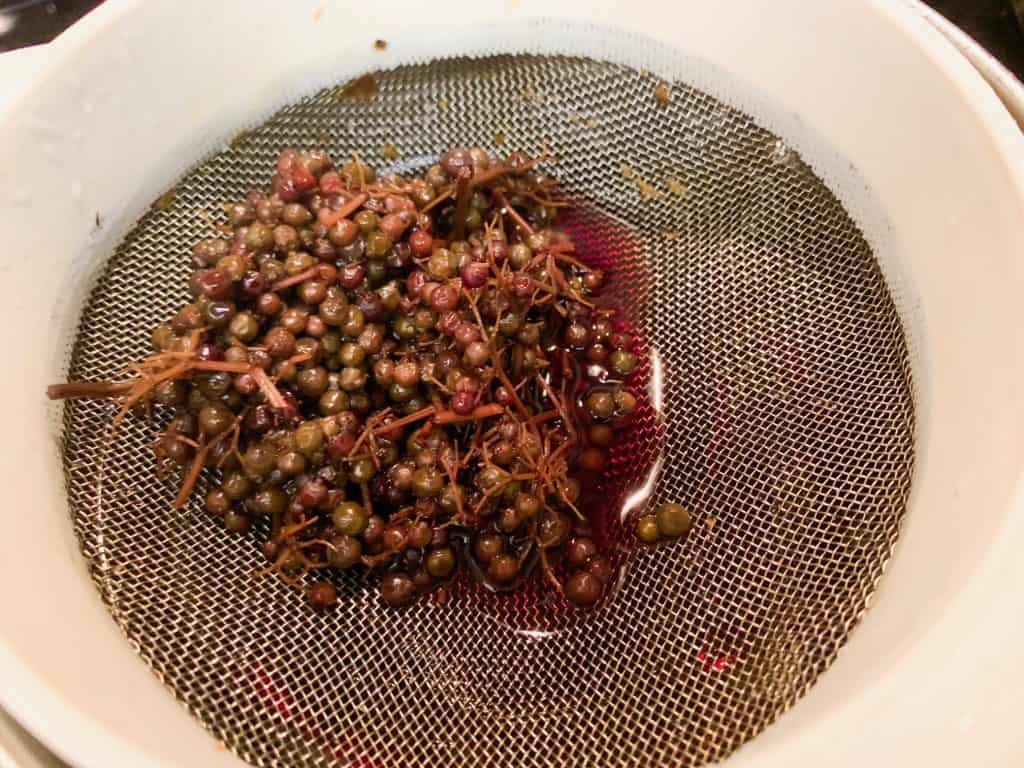strained elderberries after making syrup