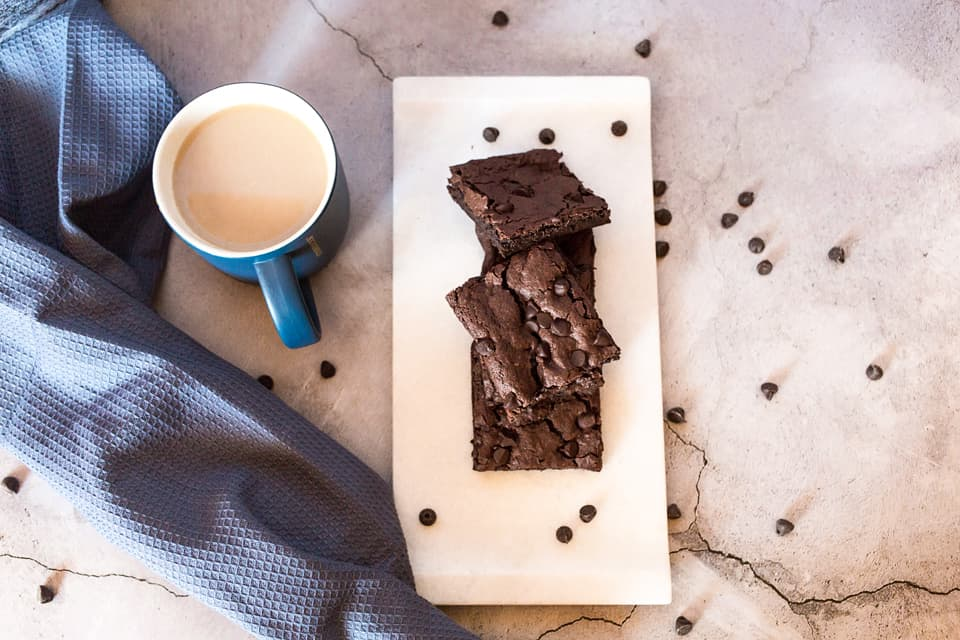vegan brownie recipe as shown from above view with cup and chocolate chips