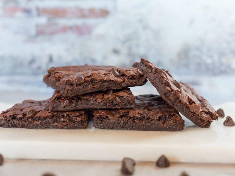fudgy vegan brownies on a pan up close
