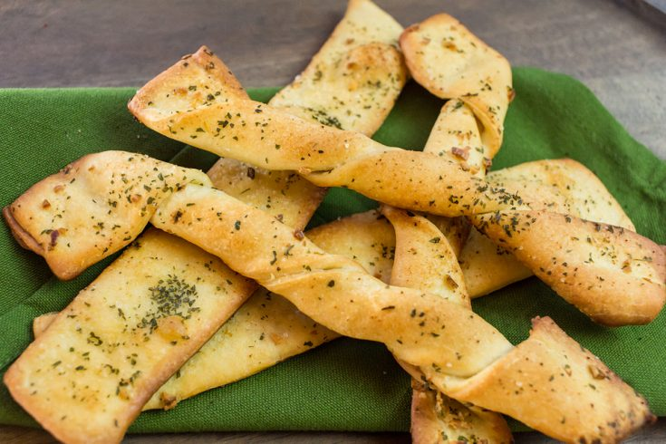 close up of vegan breadsticks on a green towel
