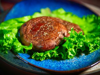 Close up of Portobello steaks on lettuce