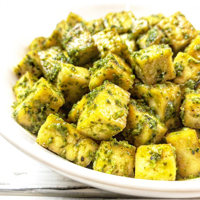 Photo of baked pesto tofu which is one of the best vegan recipes for kids