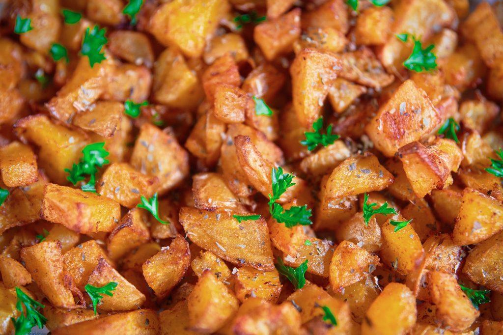vegan oven roast potatoes close up in a dish