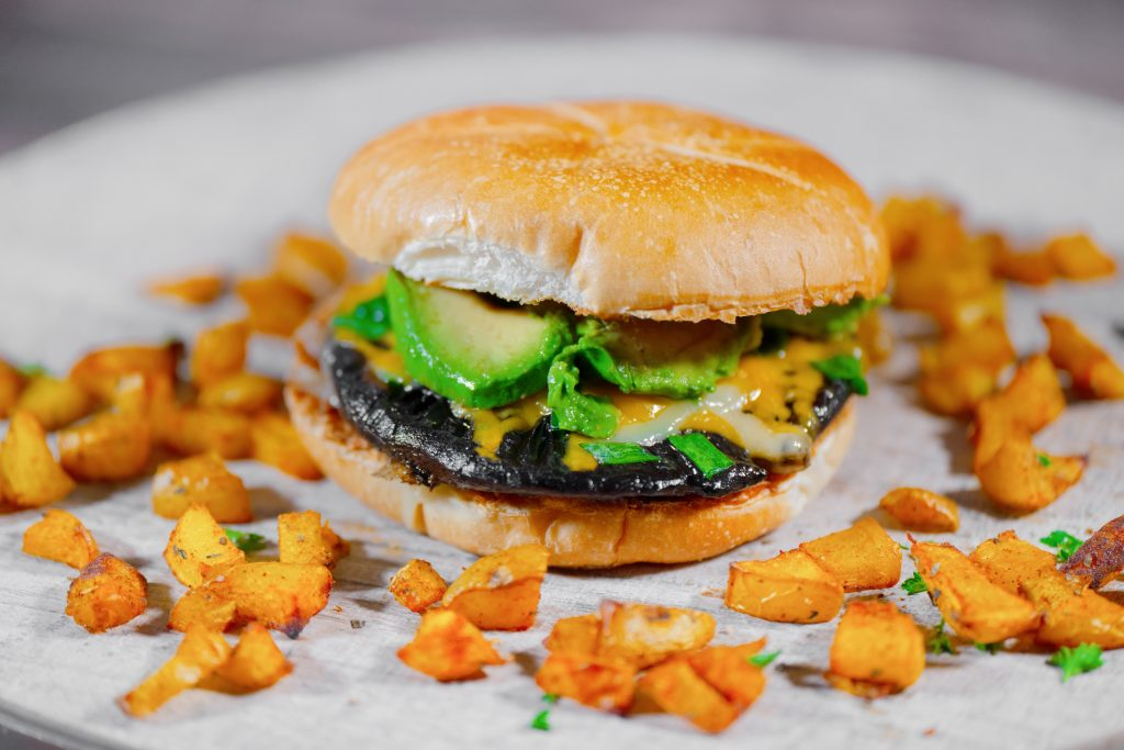 vegan portobello mushroom burger with avocado and potatoes