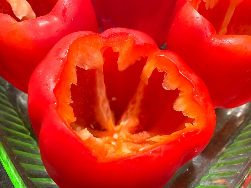 close-up of vegan stuffed peppers cored in dish