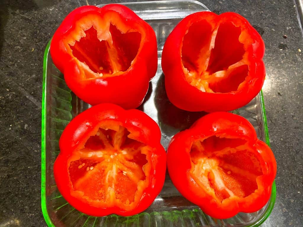 vegan stuffed peppers cored in dish