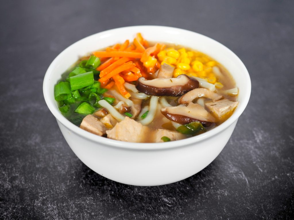 warm bowl of udon noodles with vegan broth