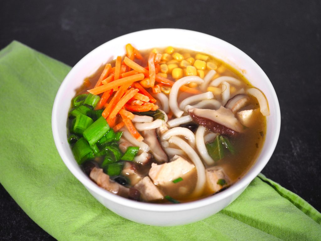 raw toppings on vegan udon noodle soup
