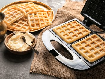 waffle maker with removable plates with two waffles and butter