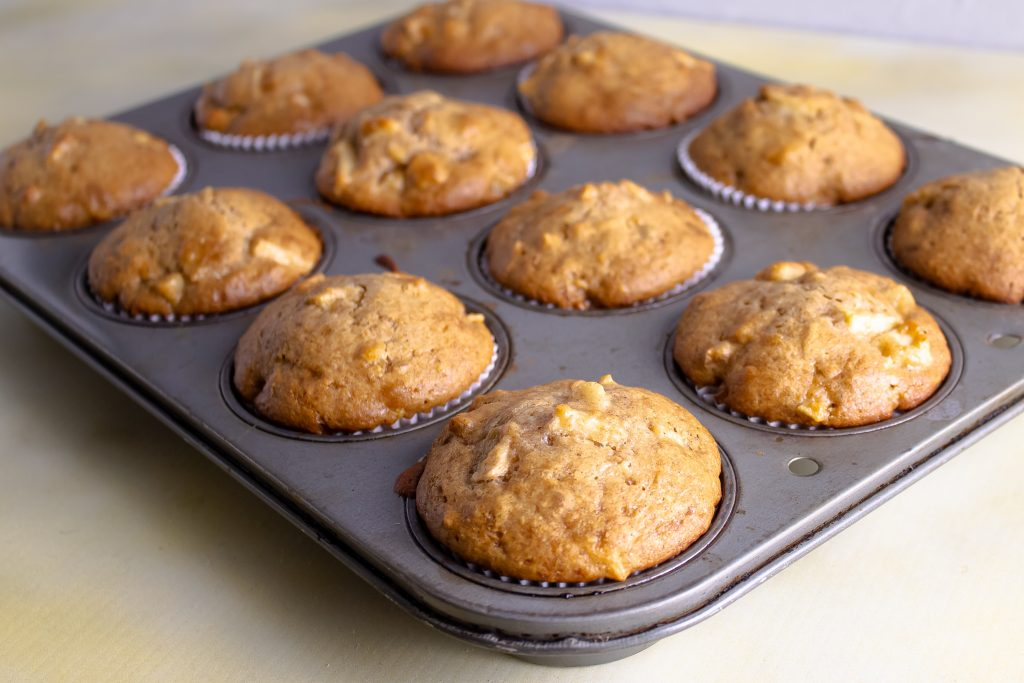 comforting apple muffins in muffin tin