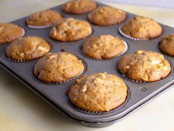 apple walnut muffins in muffin tin