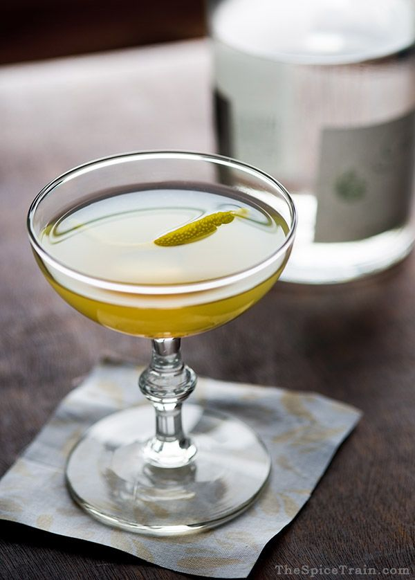 Photo of the bee's knees cocktail being served with a simple rind garnish. One of the more elegant among the easy cocktails to make at home.