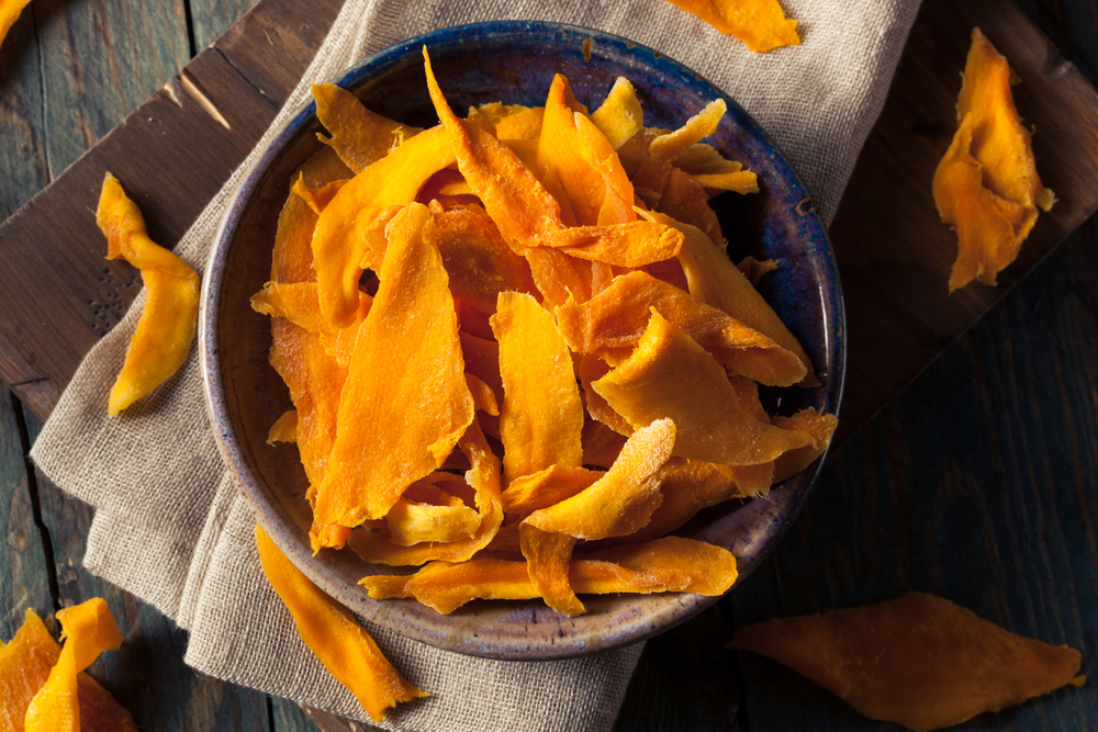 Dehydrated mangoes is one of the many tasty food options you can make in a food dehydrator!