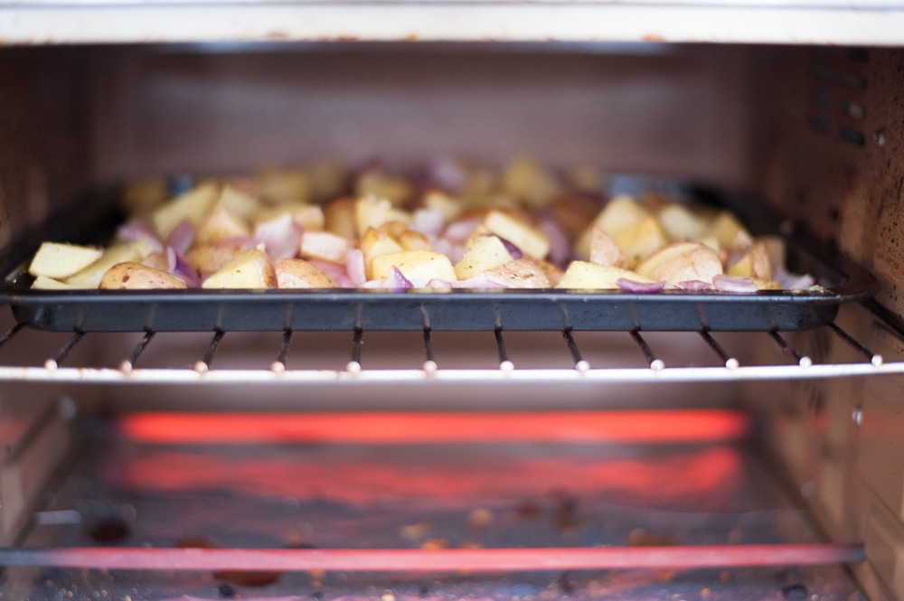 Roasted potatoes cooking in a toaster oven