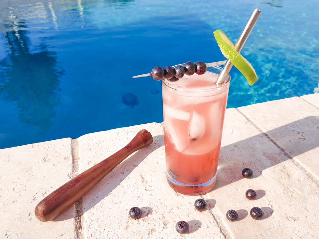 muddler with blueberries and finished blueberry vodka recipe