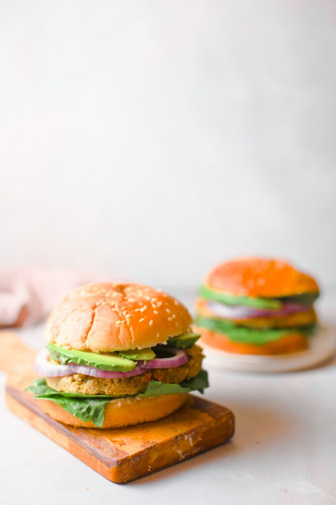 two chickpea veggie burgers on white counter