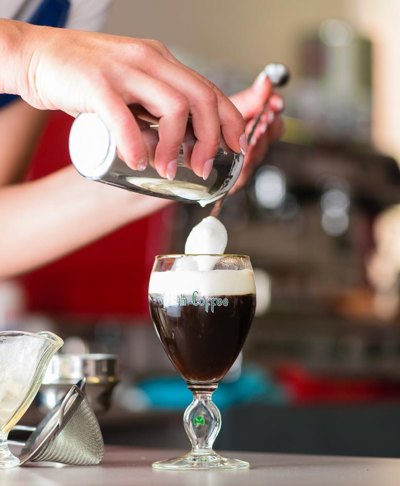 Person making an Irish Coffee