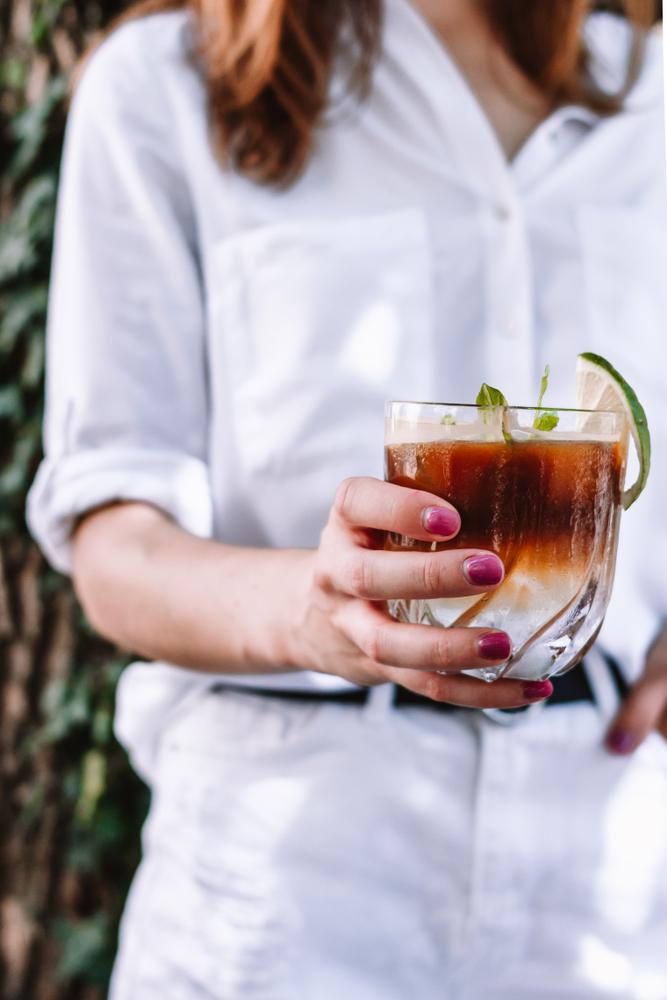 A women holding an espresso tonic