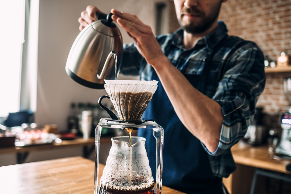 Man preparing a pour over coffee. Of all the different types of coffee this is the one you can most control.