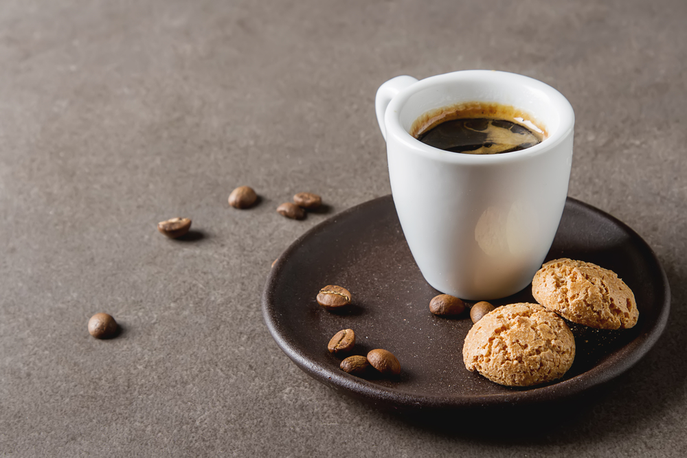 espresso on table with biscuits