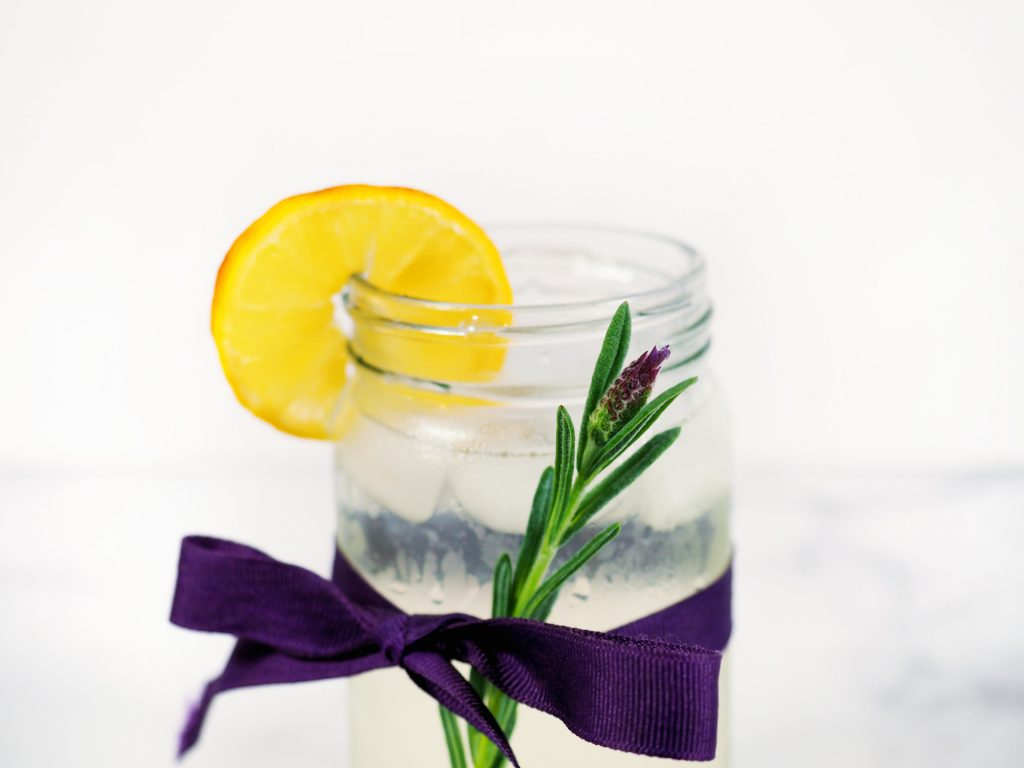 lavender stem on the outside of cup of lemonade