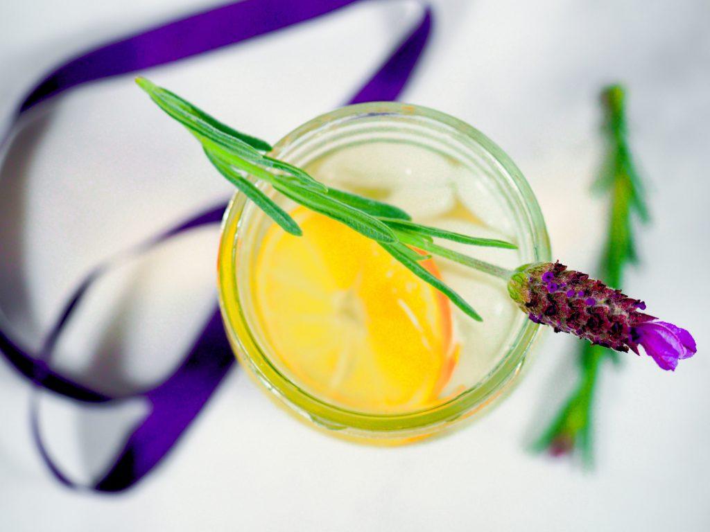lavender on top of glass of fresh lemonade
