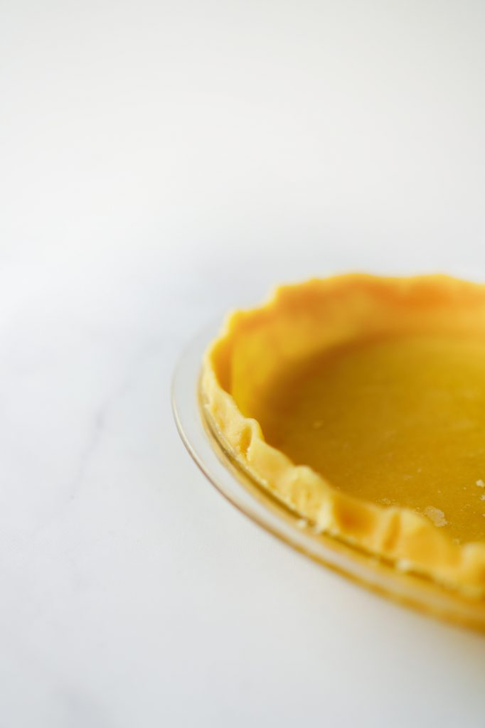side of flaky pie crust with oil