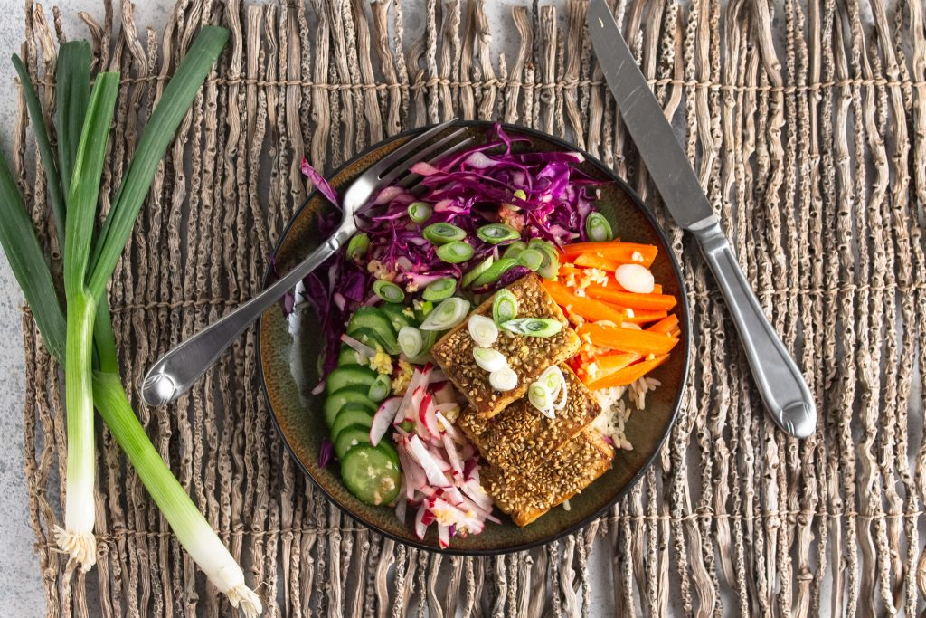 overhead view of sesame tofu on vegan power plate