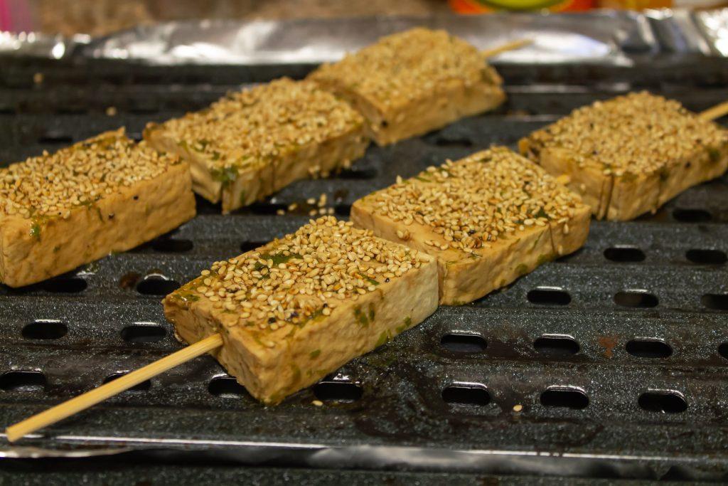 sesame tofu ready for baking on skewer
