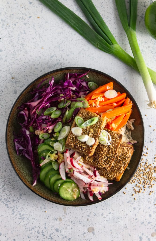 above view of vegan power bowl using tofu crusted with sesame seeds