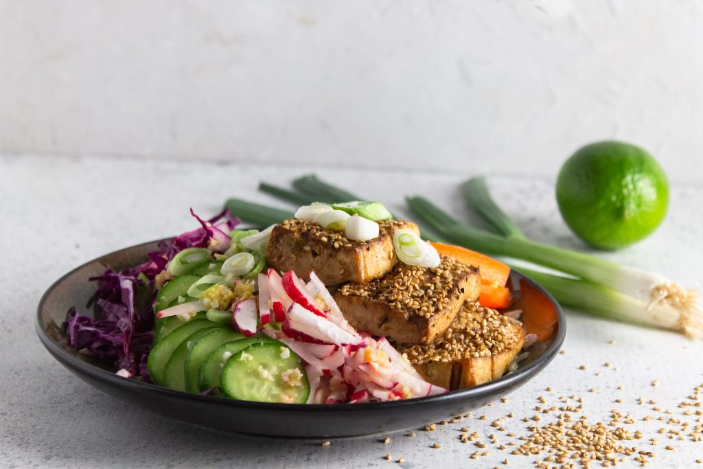 baked sesame tofu power plate on white counter
