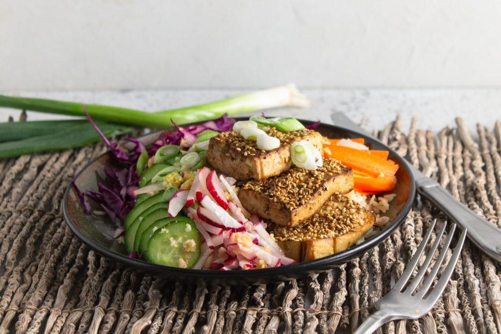 close up of vegan power bowl with sesame tofu