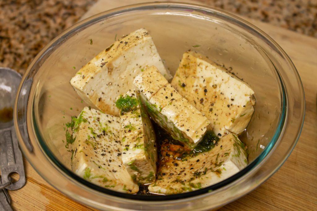 sesame tofu marinating in bowl