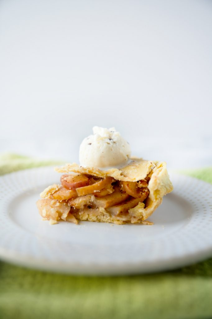 vegan apple pie with vegan ice cream on the slice