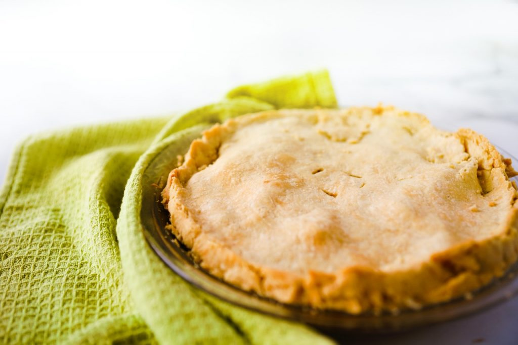 vegan apple pie with green dish towel