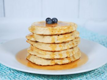 easy vegan banana pancakes on plate with syrup