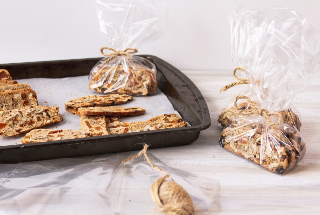 vegan biscotti wrapped in small bags on pan