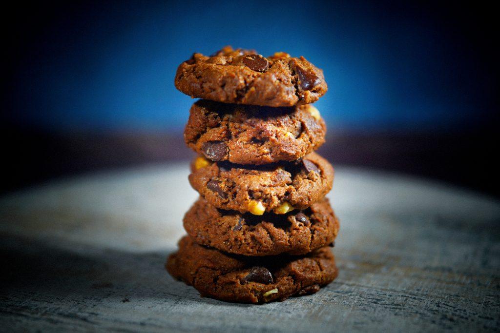 vegan chocolate cookies on blue background