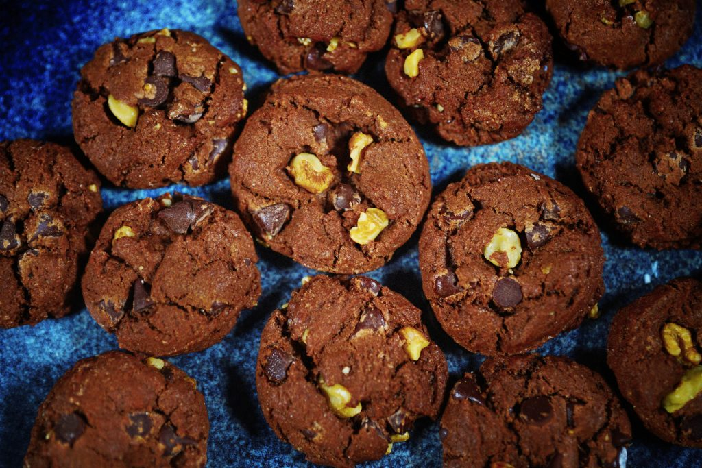 close up view of vegan chocolate cookies on blue plate