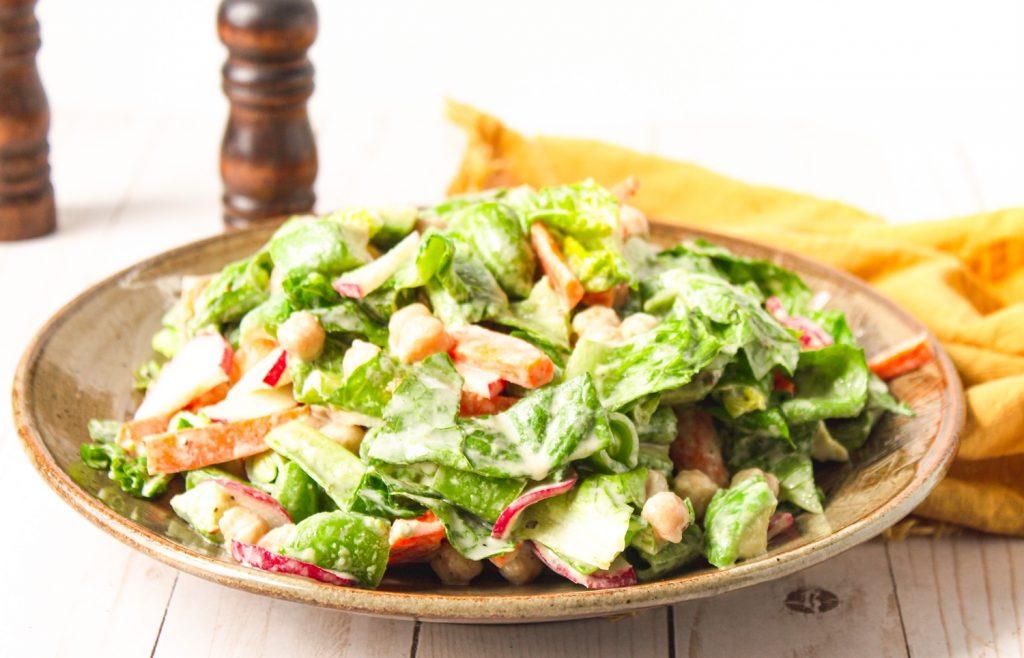close up of vegan chop salad on plate