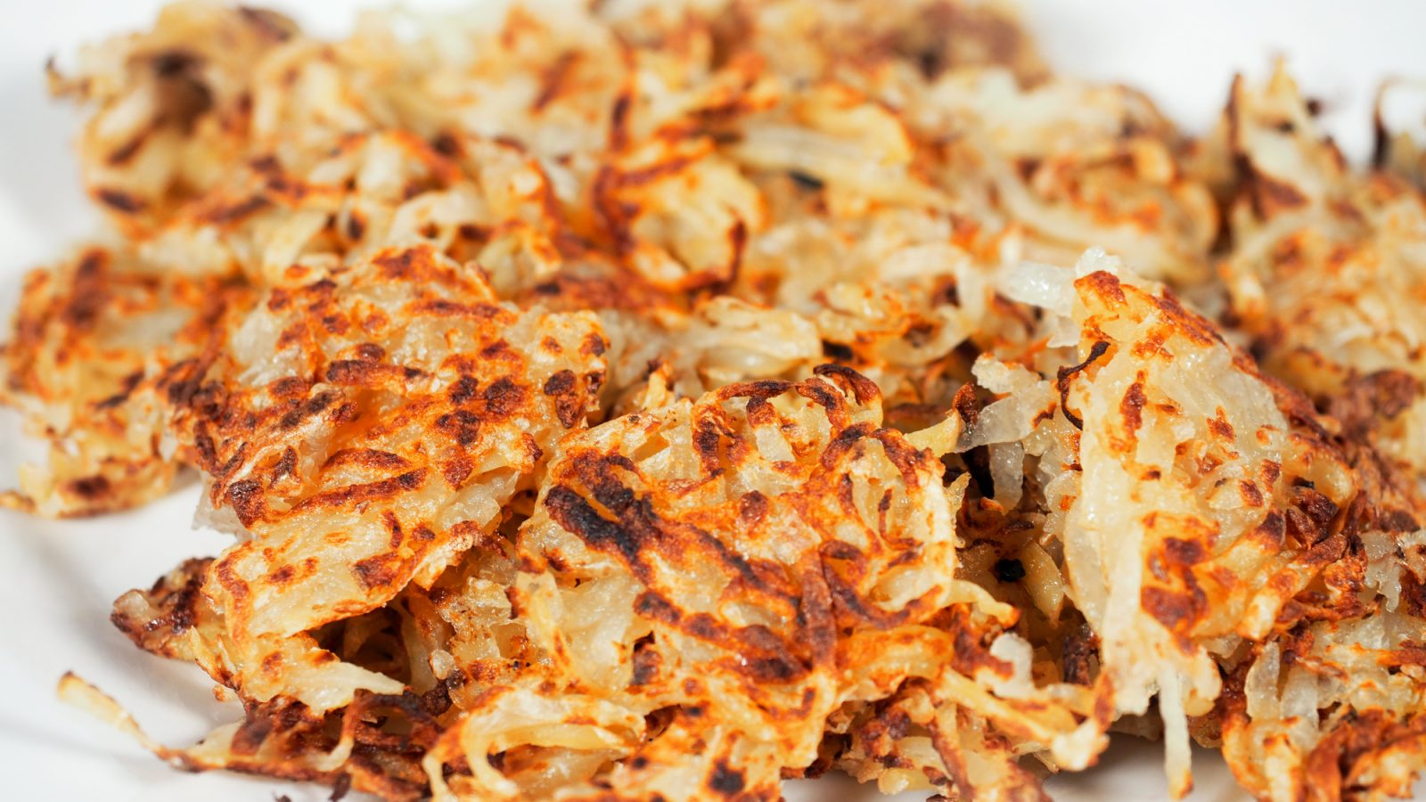 close up of cooked vegan hash browns