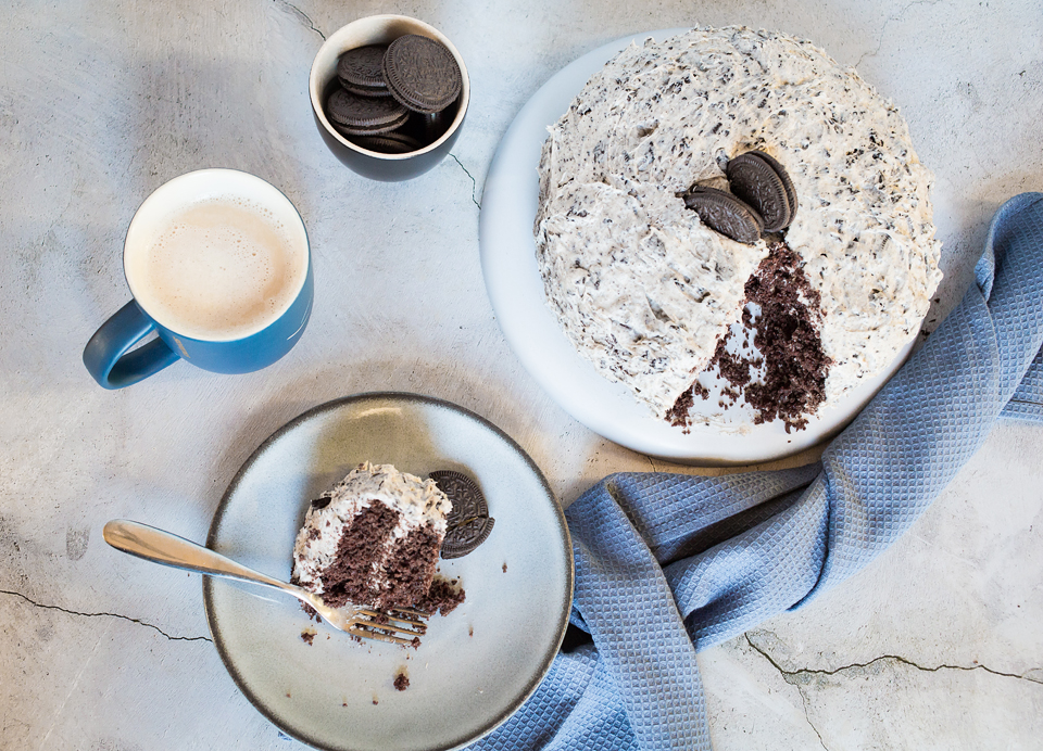 above photo of vegan oreo cake and coffee