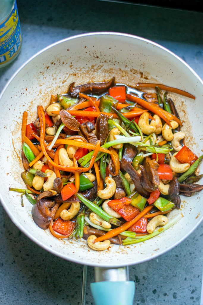 vegetables cooking in kung pao sauce
