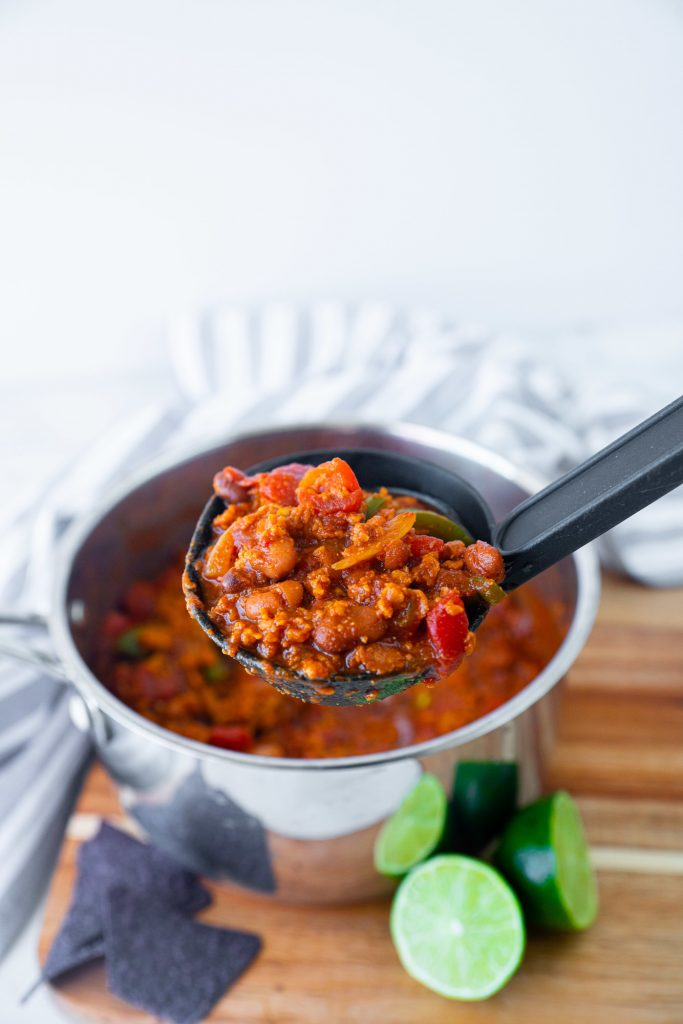 vegetarian chili in cooking pot with ladle