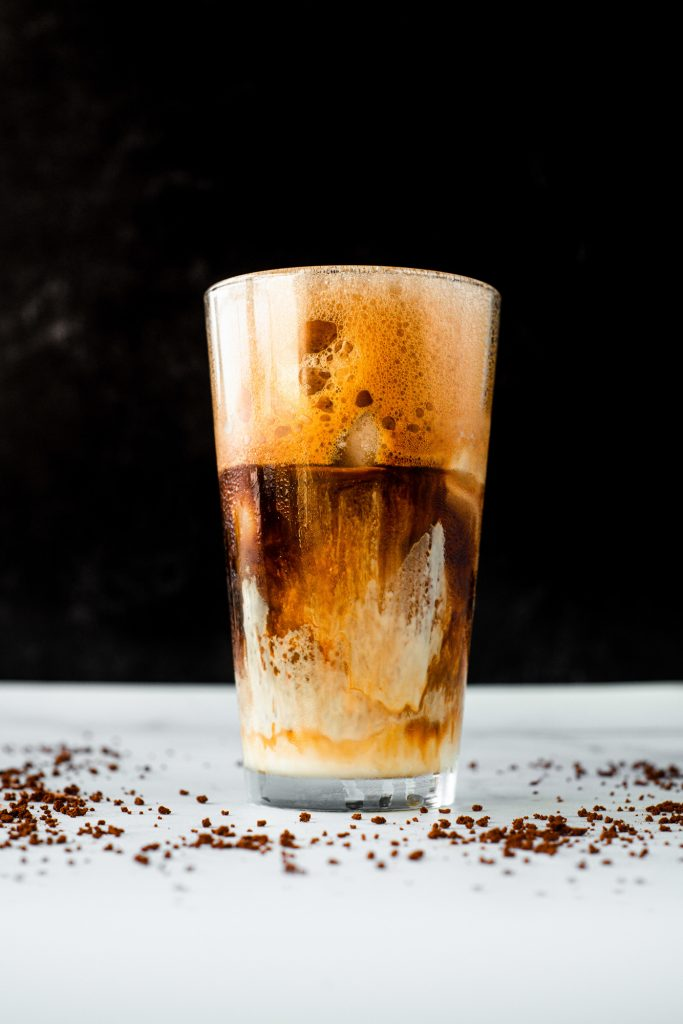 greek frappe recipe in a tall glass with black background