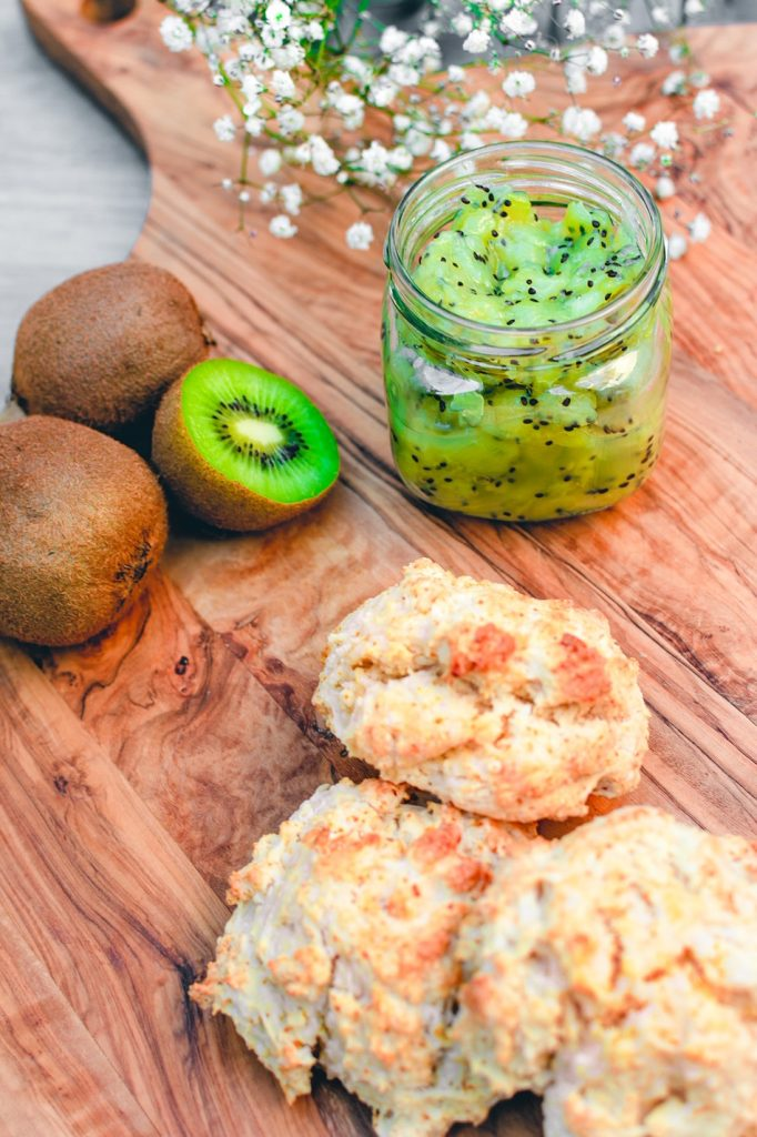 scones with kiwi jam in the background